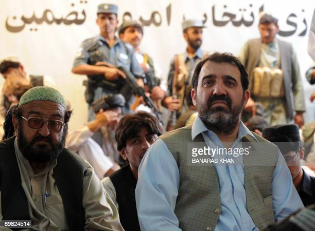 Ahmed Walli, brother of Afghan President Hamid Karzai, sits along with Karzai supporters at an election gathering in Kandahar on August 16, 2009. The...