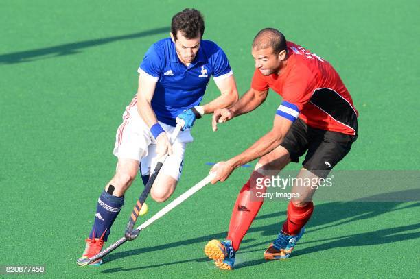 Ahmed Wzz of Egypt tackles JeanLaurent Kieffer of France during day 8 of the FIH Hockey World League Men's Semi Finals 7th8th place match between...