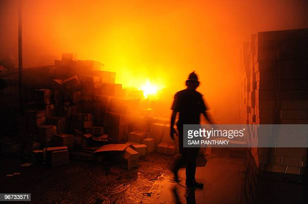 Ahmedabad Fire and Emergency Services officers fight a huge fire at a pharmaceuticals warehouse on the SanathalBavla Highway some 20 km from...