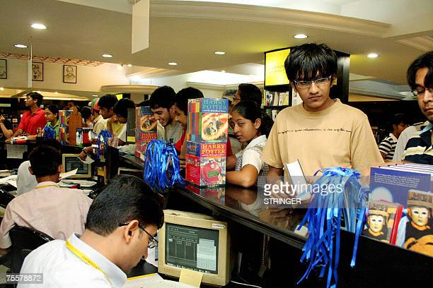 Indian customers wait at the check out to purchase Harry Potter and the Deathly Hallows at a bookstore in Ahmedabad 21 July 2007 The wait was finally...