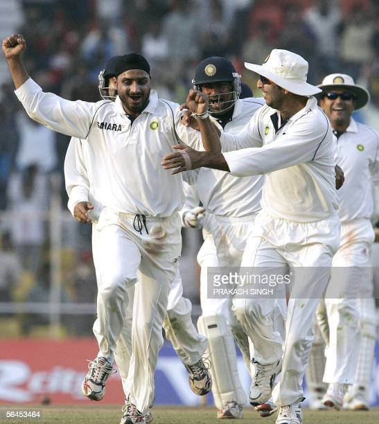 India's cricketer Harbhajan Singh celebrates the wicket of Sri Lanka's Kumara Sangakkara with teammates Yuvraj Singh during the second day of the...