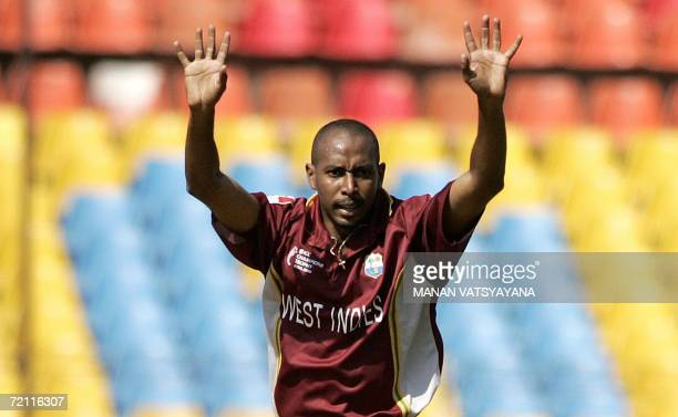 West Indies fast bowler Ian Bradshaw appeals unsuccusfully for a LBW against Zimbabwean Tafadzwa Mufambisi during the second qualifying match between...