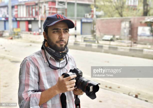 Ahmer Khan an independent photo and radio journalist during a protest on April 5 2018 in Srinagar India Advising young photographers Ahmer talks of...