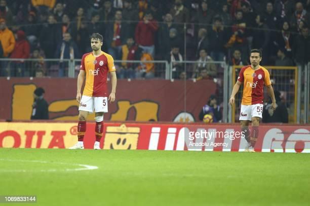 Ahmet Calik and Yuto Nagatomo of Galatasaray react after Caykur Rizespor's second goal during Turkish Super Lig soccer match between Galatasaray and...