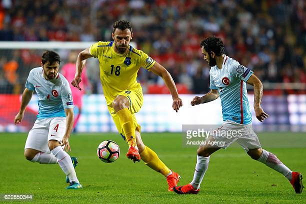 Ahmet Calik of Turkey in action against Vedat Muriqi of Kosovo during the 2018 FIFA World Cup European Qualifying Group I football match between...