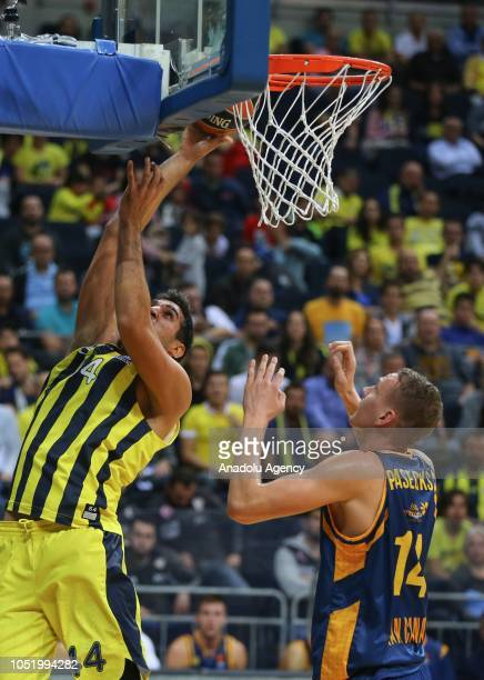 Ahmet Duverioglu of Fenerbahce in action against Anzejs Pasecniks of Herbalife Gran Canaria during Turkish Airlines Euroleague match between...