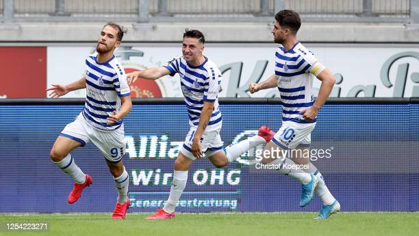 Ahmet Engin of Duisburg celebrates the first goal with Sinan Karweina and Moritz Stoppelkamp during the 3 Liga match between MSV Duisburg and SpVgg...