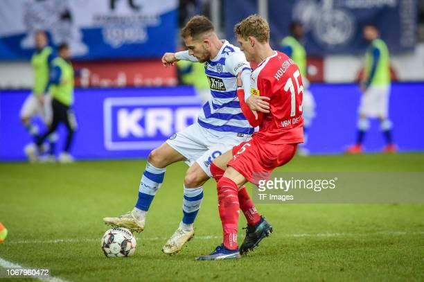 Ahmet Engin of MSV Duisburg Johannes Van Den Bergh of Holstein Kiel battle for the ball during the Second Bundesliga match between MSV Duisburg and...