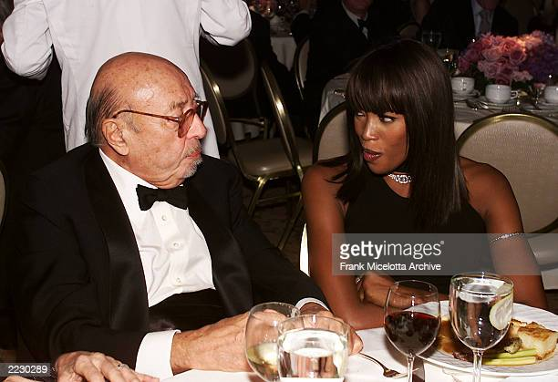 Ahmet Ertegun of Atlantic Records talks with Naomi Campbell at the 12th Annual Clive Davis PreGrammy party at the Beverly Hills Hotel in Los Angeles...