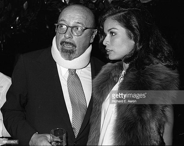 Ahmet Ertegun of Atlantic Records with Bianca Jagger at the premiere of Led Zeppelin's film 'The Song Remains The Same' at Cinema I on October 21st...