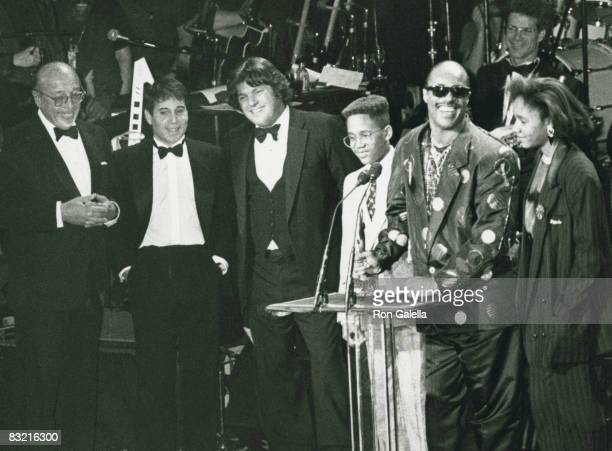 Ahmet Ertegun Paul Simon Jann Wenner Stevie Wonder son and daughter attending Fourth Annual Rock And Roll Hall Of Fame Awards on January 18 1989 at...