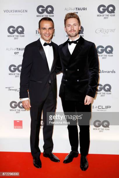 Ahmet Mercan and Marcus Butler arrive for the GQ Men of the year Award 2017 at Komische Oper on November 9 2017 in Berlin Germany