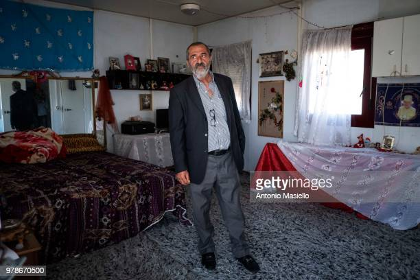 Ahmetovic Halil 50 yo of Roma ethnicity shows his home in the Barbuta camp where he lives with his family on June 19 2018 in Rome Italy Barbuta camp...