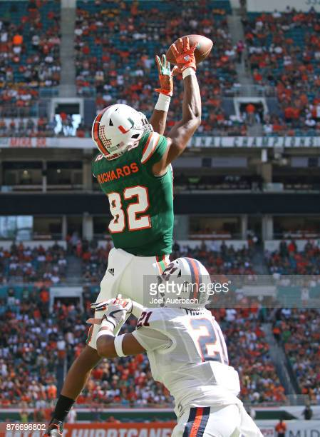 Ahmmon Richards of the Miami Hurricanes catches the ball for a touchdown over Juan Thornhill of the Virginia Cavaliers on November 18, 2017 at Hard...
