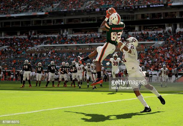 Ahmmon Richards of the Miami Hurricanes makes a touchdown catch over Juan Thornhill of the Virginia Cavaliers during a game at Hard Rock Stadium on...
