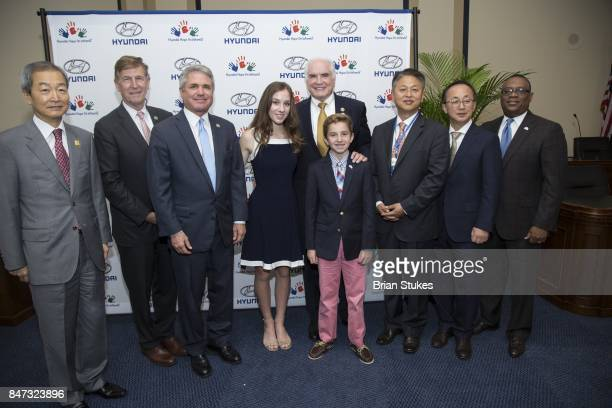 Ahn Ho-Young, Don Beyer, Mike McCall, Hannah Adams, Mike Kelly, Ryan Darby, Harry Han, Charlie Kim and Zafar Brooks attend Hyundai 'Hope For Wheels'...