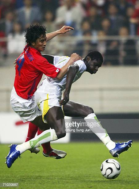 Ahn JungHwan of South Korea battles for the ball with Nguirane Ndaw of Senegal during the International friendly match at the SangAm World Cup...