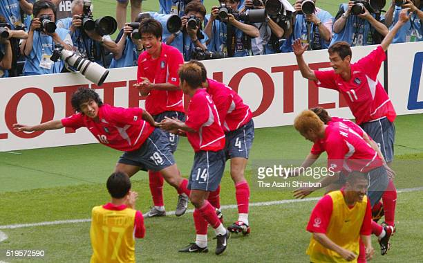 Ahn JungHwan of South Korea celebrates scoring his team's first goal with his team mates during the FIFA World Cup Korea/Japan Group D match between...