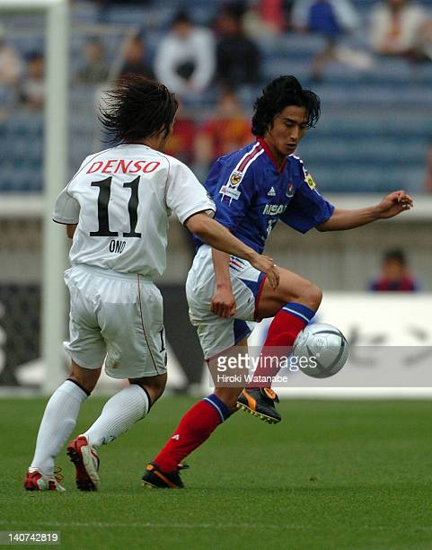 Ahn JungHwan of Yokohama FMarinos and Harutaka Ono of Nagoya Grampus Eight compete for the ball during the JLeague match between Yokoahama FMarinos...