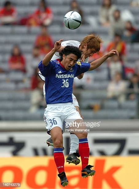 Ahn JungHwan of Yokohama FMarinos and Masahiro Koga of Nagoya Grampus Eight compete for the ball during the JLeague match between Yokoahama FMarinos...