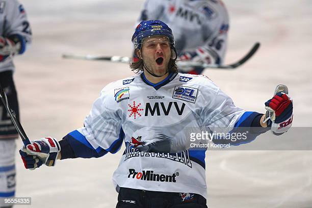 Ahren Spylo of Adler Mannheim celebrates the fourth goal during the DEL match between Iserlohn Roosters and Adler Mannheim at the Ice Sports Hall...