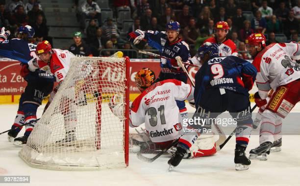 Ahren Spylo of Adler scores the 23 goal against goalie Levente Szuper of Scorpions during the Deutsche Eishockey Liga game between Adler Mannheim and...