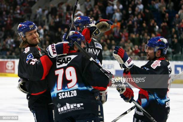Ahren Spylo of Mannheim celebrates his team's third goal with team mates during the DEL match between Adler Mannheim and ERC Ingolstadt at the SAP...