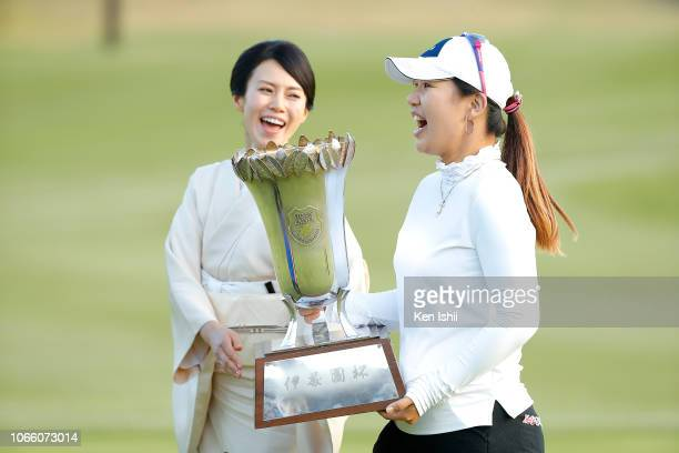 AhReum Hwang of South Korea and actress Miki Nakatani hold the winner's trophy after winning the ItoEn Ladies at the Great Island Club on November 11...