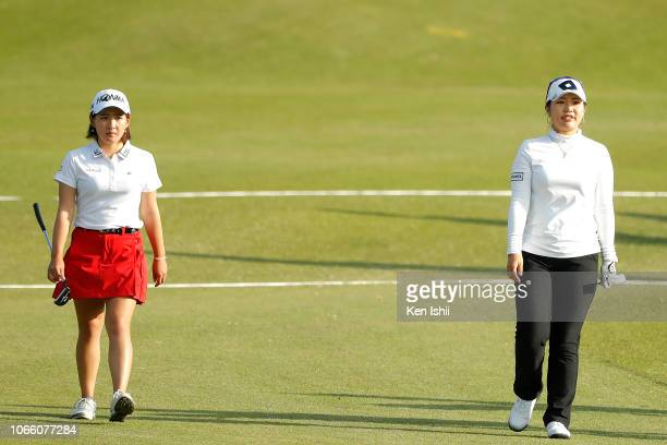 AhReum Hwang of South Korea and Kana Nagai of Japan walk on the 18th hole during the final round of the ItoEn Ladies at the Great Island Club on...