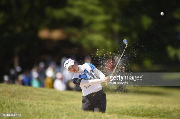 AhReum Hwang of South Korea hits out of the bunker on the 8th hole during the final round of the Stanley Ladies at Tomei Country Club on October 7...
