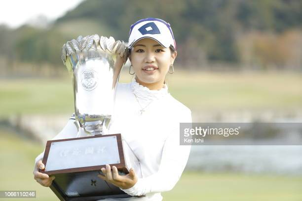 AhReum Hwang of South Korea holds the winner's trophy after winning the ItoEn Ladies at the Great Island Club on November 11 2018 in Chonan Chiba...