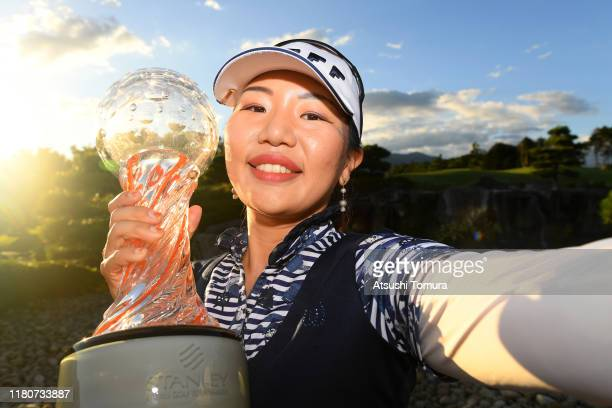 Ah-Reum Hwang of South Korea imitates selfie photographs after winning the tournament following the final round of the Stanley Ladies at Tomei...
