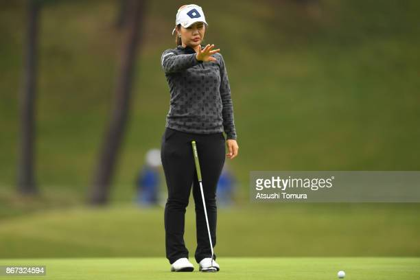 AhReum Hwang of South Korea lines up her putt on the 17th hole during the second round of the Higuchi Hisako Ponta Ladies at the Musashigaoka Golf...