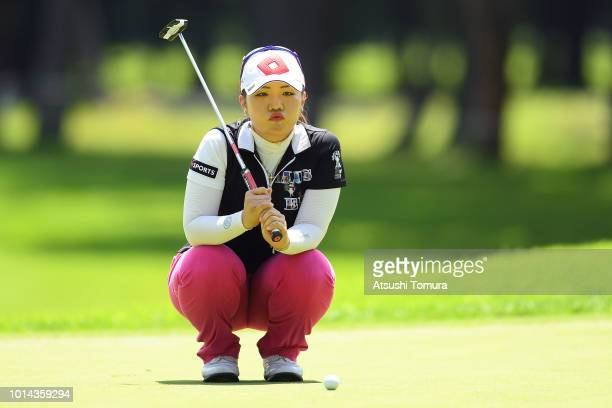 AhReum Hwang of South Korea lines up her putt on the 4th hole during the first round of the Karuizawa 72 Golf Tournament at the Karuizawa 72 Golf...