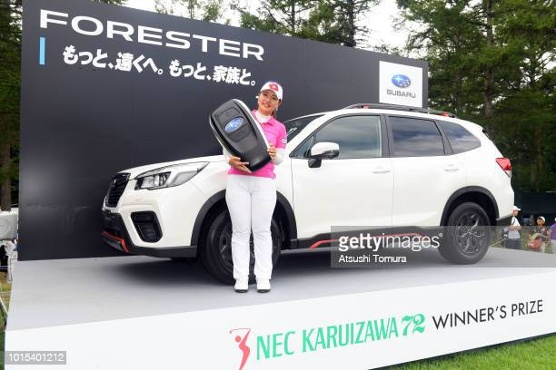 AhReum Hwang of South Korea poses with a prize car after wainning the Karuizawa 72 Golf Tournament at the Karuizawa 72 Golf North Course on August 12...
