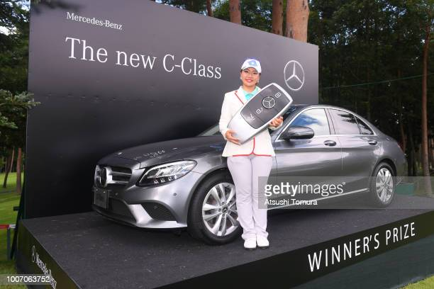 AhReum Hwang of South Korea poses with the prize car after winning the Daito Kentaku Ehayanet Ladies at the Narusawa Golf Club on July 29 2018 in...