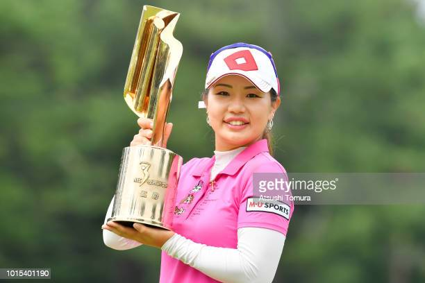 AhReum Hwang of South Korea poses with the trophy after wainning the Karuizawa 72 Golf Tournament at the Karuizawa 72 Golf North Course on August 12...