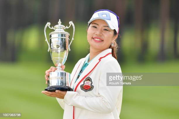 AhReum Hwang of South Korea poses with the trophy after winning the Daito Kentaku Ehayanet Ladies at the Narusawa Golf Club on July 29 2018 in...