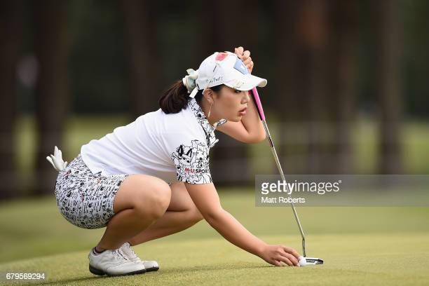 AhReum Hwang of South Korea prepares to putt on the 2nd green during the third round of the World Ladies Championship Salonpas Cup at the Ibaraki...