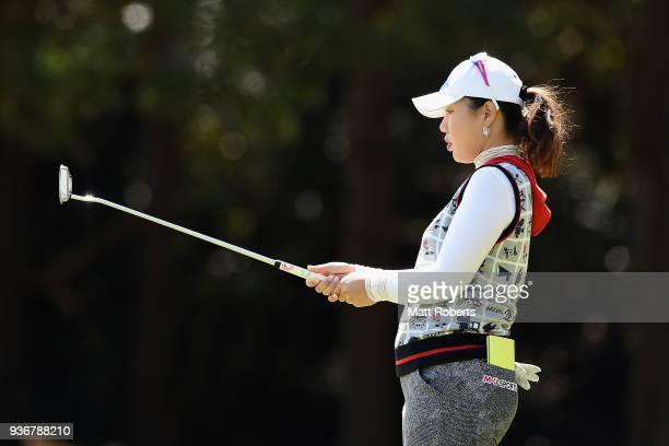 AhReum Hwang of South Korea prepares to putt on the first green during the first round of the AXA Ladies Golf Tournament In Miyazaki at the UMK...