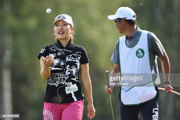 AhReum Hwang of South Korea reacts after her putt on the 18th green during the third round of the 50th LPGA Championship Konica Minolta Cup 2017 at...