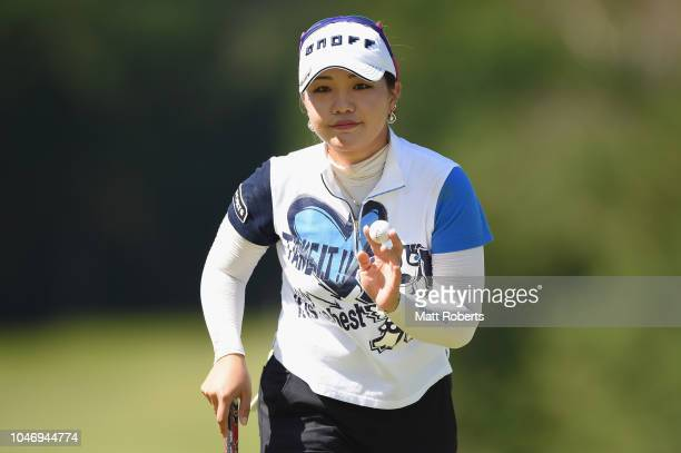 AhReum Hwang of South Korea reacts after her putt on the 8th hole during the final round of the Stanley Ladies at Tomei Country Club on October 7...