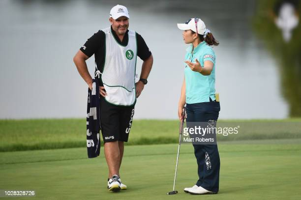 AhReum Hwang of South Korea shares a laugh with her caddie during the second round of the 2018 LPGA Championship Konica Minolta Cup at Kosugi Country...