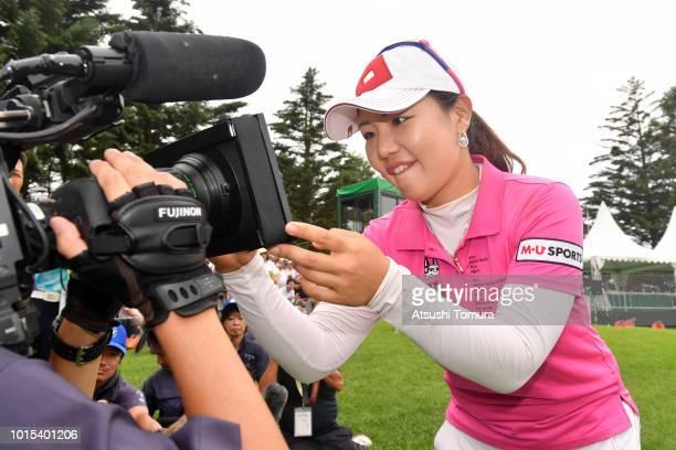 AhReum Hwang of South Korea signs an autograph on the TV camera after wainning the Karuizawa 72 Golf Tournament at the Karuizawa 72 Golf North Course...