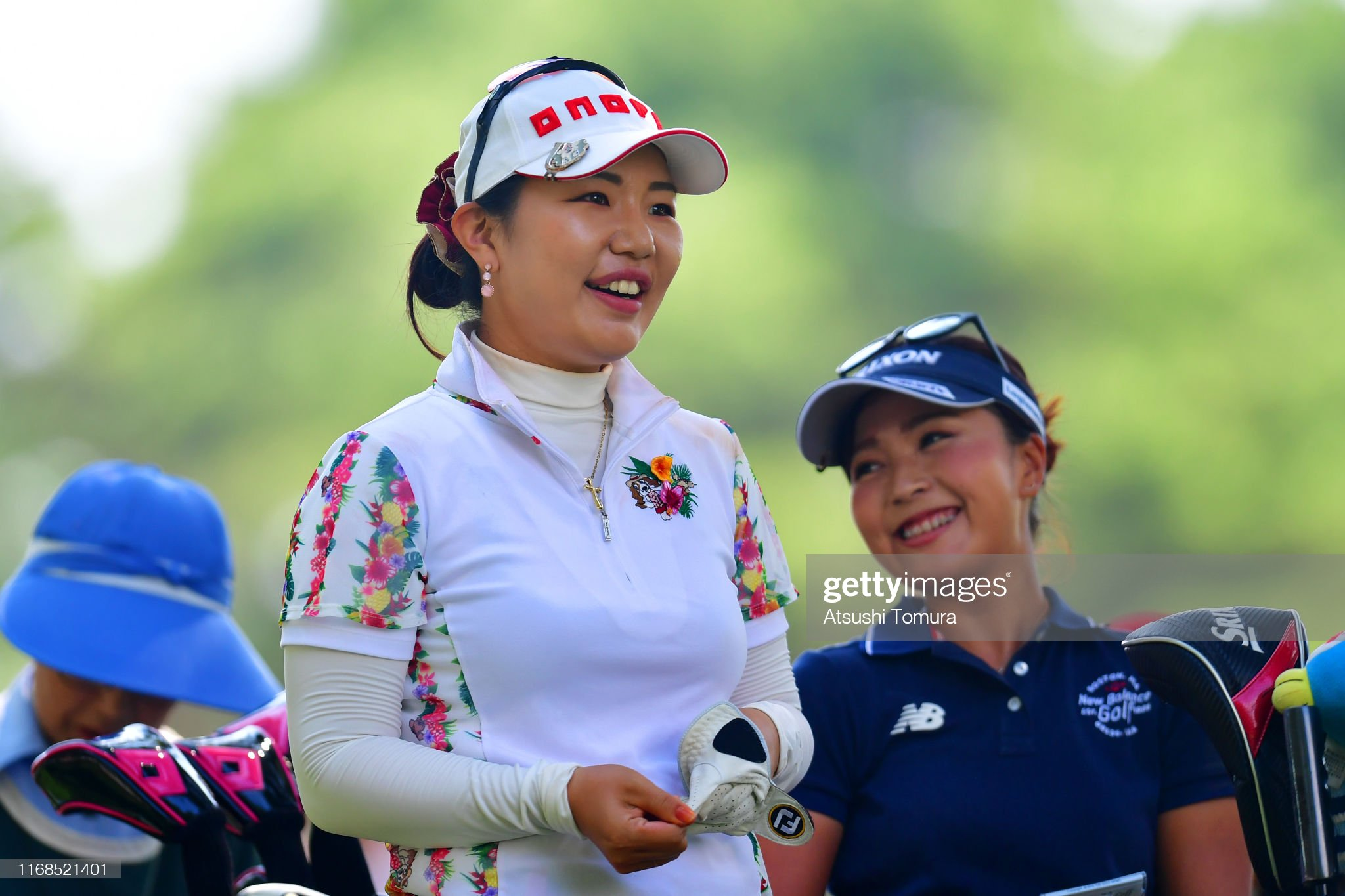 https://media.gettyimages.com/photos/ahreum-hwang-of-south-korea-smiles-after-her-tee-shot-on-the-17th-picture-id1168521401?s=2048x2048
