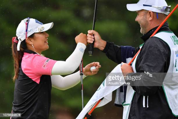 AhReum Hwang of South Korea smiles after making her birdie putt on the 13th hole during the final round of the 2018 LPGA Championship Konica Minolta...