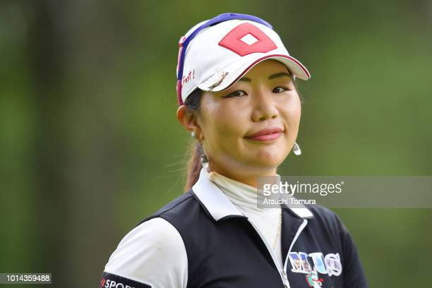 AhReum Hwang of South Korea smiles during the first round of the Karuizawa 72 Golf Tournament at the Karuizawa 72 Golf North Course on August 10 2018...
