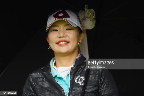 AhReum Hwang of South korea smiles during the first round of the Japan Women's Open Golf Championship at Chiba Country Club Noda Course on September...