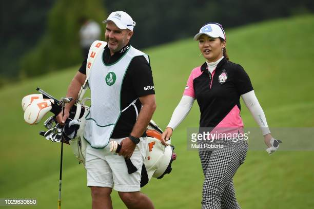 AhReum Hwang of South Korea speaks with her caddie during the final round of the 2018 LPGA Championship Konica Minolta Cup at Kosugi Country Club on...