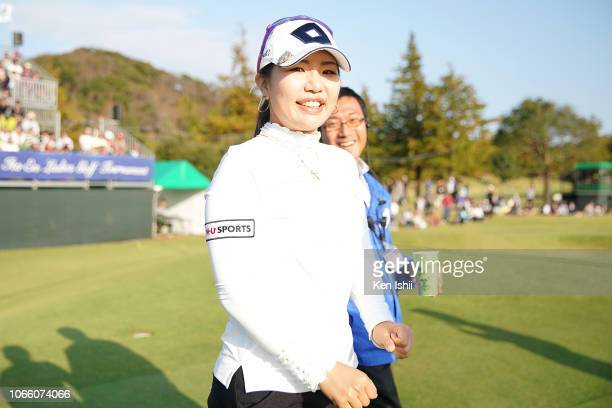 AhReum Hwang of South Korea walks on the 18th hole green after winning the ItoEn Ladies at the Great Island Club on November 11 2018 in Chonan Chiba...